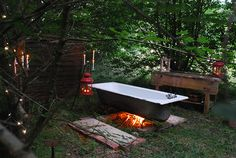 Just beyond the garden on the edge of the wood stands Louisa Thomsen Brit's old metal bath. Sinking into its waters warmed by the fire below she reflects on the charms of bathing outdoors Read more at travels.Bathing outside feels like an ancient rit Outdoor Bathtub, Outdoor Bathrooms, Outdoor Showers, Outdoor Spaces, Outdoor Living, Outdoor Decor, Jacuzzi, Cast Iron Tub, Glamping