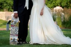 Skateboarder Groom and heirloom vintage silk wedding dress at Rochester Wedding at the Memorial Art Gallery for Dan and Cristin by top wedding photographer Heather McKay www.mckaysphotography.com