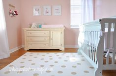 We went with Benjamin Moore's Pink Orchid for the walls. It is a soft pale pink... It's perfect! The crib as I blogged about before, is Benjamin Moore's Palladian Blue... I chose two accent colors for the room... Pale blue and gold... I'm crazy about how they all go together!