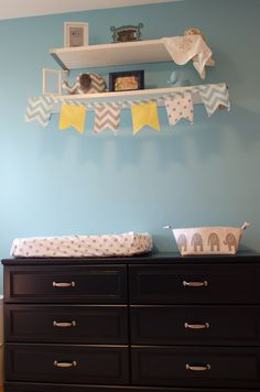 Bunting on a shelf adds a fun pop of color + pattern! #nursery