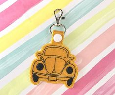 Check out our snap tab design selection for the very best in unique or custom, handmade pieces from our shops. Bug Car, Wave Design, Love Bugs, Key Fobs, Machine Embroidery Designs, Volkswagen, Personalized Items, Digital, Hoop