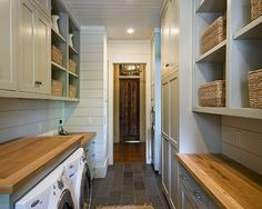 This looks just like the laundry room I dream about! Surely, the clothes pile is behind the photographer.