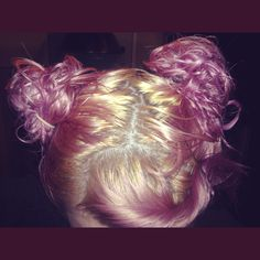 Blonde roots, fresh pink, messy buns, wet hair.