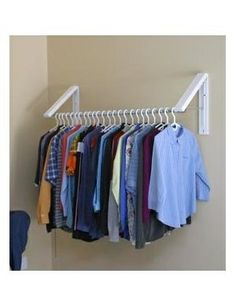 Arrow Hanger AH3X12 Quik Closet Clothes Storage System. Wall mounted, retractable hanging rack for small laundry room.