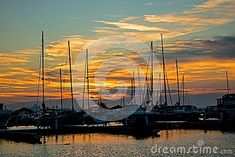 Sail boats sit quietly in the marina at Port Credit, Ontario Mississauga as the sun rises over Lake Ontario with the downtown Toronto skyline in the background. Toronto Skyline, Downtown Toronto, Sail Boats, Sailing Ships, Ontario, Sunrise, Stock Photos, Sunrises, Sailboat