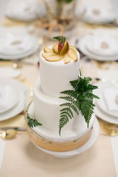 wedding cake topped with pear slices, photo by Photo by Betsy http://ruffledblog.com/austin-spring-wedding-inspiration #weddingcake #cakes