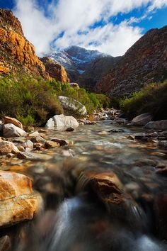 tributary to the Seweweekspoort River, snow covered Swartberg Mountains, South Africa
