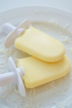 Pineapple Coconut Popsicles- a super tropical treat with the refreshing tastes of pineapple and coconut. More