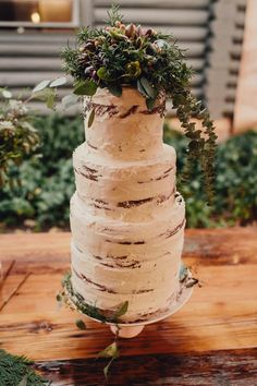 Rustic cake with foliage on top   image by Taylor Roades