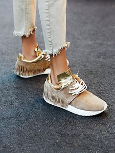Ramapo Fringe Sneaker   Suede sneakers featuring fun fringe detailing on the heel and metallic-dipped accents. Lace-up closure and cushioned rubber sole.