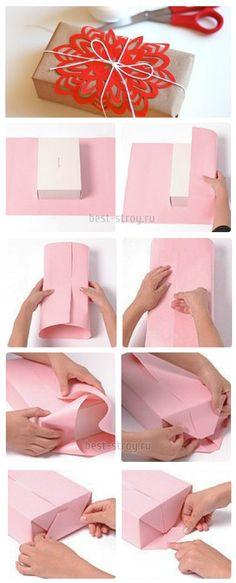 Пошаговая инструкция как красиво упаковать подарок на Новый год.
