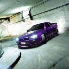 Here ya' go @naomisherbundy....it's a Purple Nissan Skyline!!!