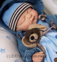 One of a kind sculpted baby with OOak outfit.  Crocheted huggie lovey dog blanket toy.. 10 inches