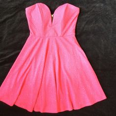 🔴SALE🔴Hot Pink Strapless Dress You will look super chic in this strapless dress in hot pink shimmery fabric.  It is fully lined underneath and has a fashionable back zipper. You can go anywhere in this dress.  It looks really cute with a bralette underneath. Excellent pre worn condition-WORN ONLY ONCE‼️ Honey and Rosie Dresses Strapless