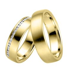 """""""Métiers Wedding Bands"""" (by Métiers Collection) The Métiers wedding bands insist in detailed craftsmanship, matching the classic with modern touches. The symbol of your love and commitment crafted in the most refined way is set in 18K Yellow Gold. The pair with its special engraving and its sparkling diamonds enables the creation to shine with maximum luster. For her, the band has 40 diamonds (0.80ct). For him, the band is plain. Available in all varieties of gold tones and qualities."""