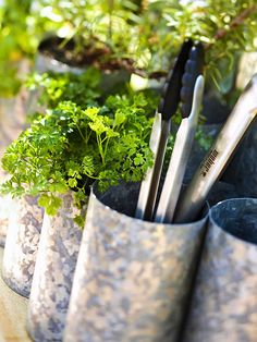 A galvanized wine rack makes for an inexpensive container for fresh herbs. See the rest of this relaxing deck: http://www.bhg.com/home-improvement/deck/ideas/deck-design-ideas/?socsrc=bhgpin042113herbplanter=8