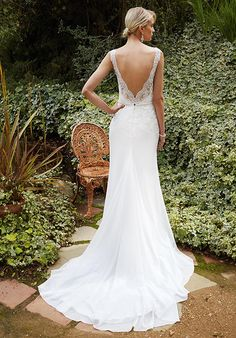 Full-length chiffon modified A-line gown features illusion lace straps and romantic sweetheart neckline. A Guipure lace bodice with beaded appliqué at the natural waist includes low illusion V-back.