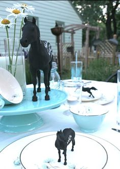 $1 dollar tree horses...  I painted mine gold, blue, pink & silver...hadn't thought of chalkboard paint for name cards!