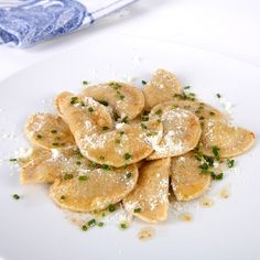 """""""Schlutzkrapfen""""  pasta stuffed with spinach and ricotta, served with melted butter and parmesan cheese at the top (and chive if you like)"""