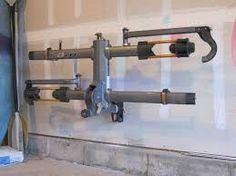 Wall storage mount for hitch mounted bike racks.