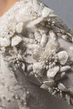 """Ivory tulle ball-gownwith embellished top and puff flower appliques, silk bow waist 