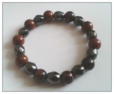 Handmade Jewellery - Bracelet 10.00. A gift idea by Jean Wilson found on www.MyOwnCreation.co.uk: This semi precious stretchy bracelet is made with mahogany obsidian and faceted oval hemetite. A wonderful gift for Fathers day, when you order this bracelet it will come with a small handmade pillar gift box(flat pack), tissue paper and a blank gift card. Colours will vary