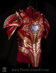 The cuirass (body armor) features overlapping red/gold details. The patterned gold goes up the chest leading to the arc reactor, which is a beautiful, sky blue.