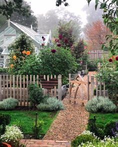Dreamy garden with fence, gravel path and greenhouse garden cottage Garden Cottage, Home And Garden, Farmhouse Garden, Spring Garden, Farmhouse Homes, House Garden Design, Garden Homes, Prairie Garden, Garden Kids