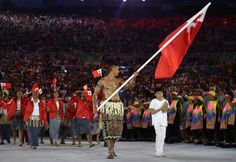 This is taekwondo player Pita Taufatofua, leading Tonga's team of seven athletes. | Tonga's Oiled Up Flag Bearer Was The Highlight Of The…