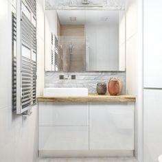 Zdjęcie: mała biała szafka z drewnianym blatem pod umywalkę