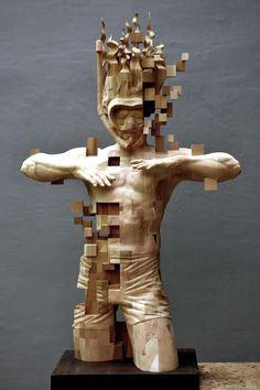 A Pixelated Wooden Snorkeler Sculpted by Hsu Tung Han