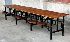 Cafeteria table. Gather family and friends around this industrial cafeteria table. Made with a reclaimed pine wood top and 12 oak wood seats that swivel in and out for added comfort.