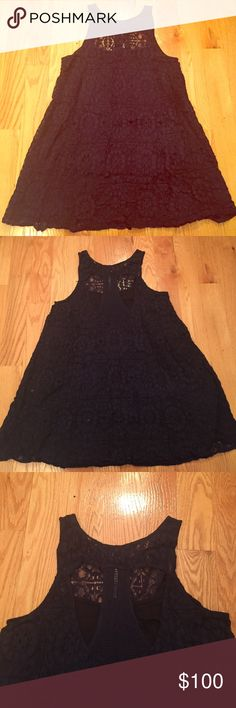 Free People Eyelet Mini Dress Absolutely gorgeous babydoll dress from Free People with eyelet design and a racerback back. Lined, worn once, cotton nylon blend, amazing dress for parties and going out. Wish that it still fit me! Free People Dresses Mini