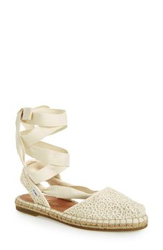 Swooning over this lace up espadrilles with a floral crochet pattern.