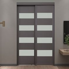 """Enhance the look of your entryway, bedroom or storage area with the modern styling of this 4-light frosted glass sliding door. Constructed using only quality materials, the frosted glass is wrapped in a sturdy MDF that will provide years of lasting enjoyment. This 72"""" wide door uses a bottom roller system ensuring a smooth and easy glide when opening or closing. Complete with installation hardware, this system is easy to install even for the novice DIY. Available in a variety of sizes to meet yo Wood Sliding Closet Doors, Modern Closet Doors, Sliding Glass Door, Modern Interior Doors, Modern Sliding Doors, Contemporary Interior, Barn Doors, Interior Ideas, Mdf Trim"""