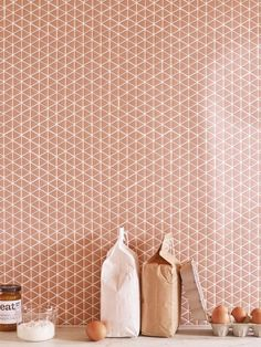 Recycled glass Confiserie series tile comes in two mosaic shapes (chevron and triangle) in four matte colors (including the Blush shown here). It arrives as an square installed on webbed backing and is suitable for use anywhere in the house;