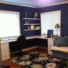 L-shaped desk using hollow wood doors and filing cabinets that I painted white.   Made by my hubby!!