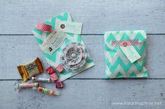 #DIY mini swag bag business cards using washi tape + glassine bags + bakers twine. Genius.