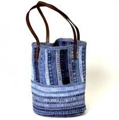 Tas gemaakt van de naden van jeans, daar heb je wel een paar broeken of rokken voor nodig!