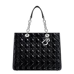 "The practical, elegant and comfortable ""Dior Soft"" collection encapsulates the Couture expertise of Dior.This black patent lambskin shopping bag is distinctive for its Dior signature 'Cannage' stitching.The practical bag contains three compartments (one with zip). Size: 40 x 26 x 15 cm - ""D.i.o.r"" letters in silver-tone metal. - 1 zipped pocket 2 open pockets Press-stud closure"