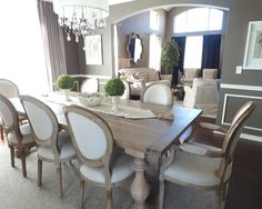 Dining room - round back dining chair - rustic finish - gray and natural tone - chandelier