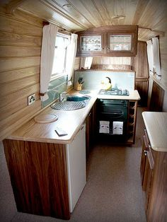 Kitchen unit, hand made in walnut with solid ash worktops. Living On A Boat, Tiny Living, Canal Boat Interior, Barge Interior, Canal Barge, Narrowboat Interiors, Houseboat Living, Narrow Boat, Tiny Apartments