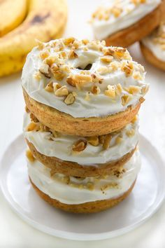Supremely moist and flavorful banana bread donuts topped with luscious cream cheese frosting! Add a sprinkle of chopped walnuts for a lovely little crunch.