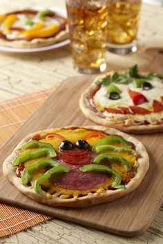 Cute, creepy mini pizzas chosen for the princess party because they are small, yum and popular! Designs may vary due to theme.