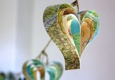 Create paper hearts from strips of recycled paper.