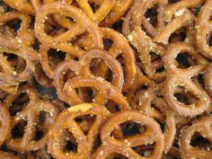 Easy recipe, no bake Spicy pretzels    Ingredients:   1 cup canola oil  1 package dry ranch mix   1 tsp garlic salt  1 tsp cayenne pepper  1 pound / 16 oz pretzels (mini work best)  1 gallon sandwich bag     Mix oil, pepper, garlic salt and dry ranch mix in a bowl.     Put pretzels in bag, pour oil mixture over pretzels, shake well and lay flat, turning every once in awhile to allow saturation. I usually let mine sit overnight.