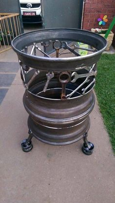 A most Awesome firepit from old rims and tools! By Pop's Art and Co.