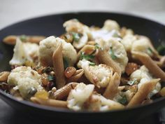 Sicilian cauliflower with whole wheat pasta. Raisins, capers, pine nuts... on the menu this week for sure.