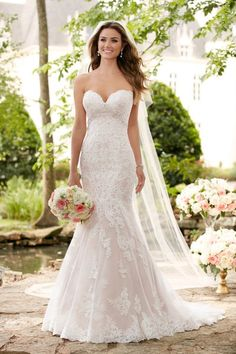 Romantic lace wedding dress features a shimmery bead work & lace pairing that creates a soft hourglass shape. Available in sizes 2 - 34. Style 6379 by @stellayorkbride.