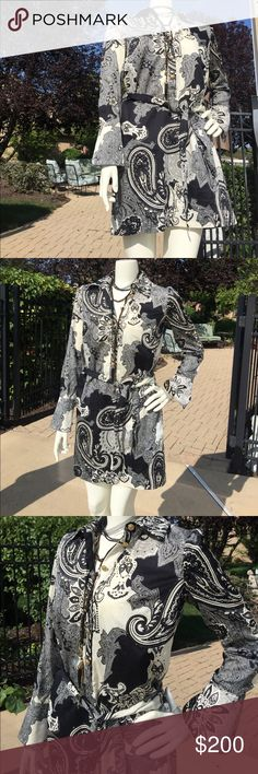 S M Neiman Marcus black white mini shirt dress 🖤 S M Neiman Marcus black white paisley mini shirt dress 🖤WOW🖤! Brand is by single dress and it retails for $240. Purchased many years back and it rare and could consider vintage at this point! All tags still attached paid $200 even back then. Labeled Med but runs Small. Fits mannequin perfectly with a little room to spare. Would consider this a size 6 to 10 max! It's an off white and black floral paisley print with an oversized flare cuff…